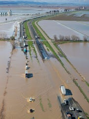 Flood water crosses over Interstate 5 at Williams,