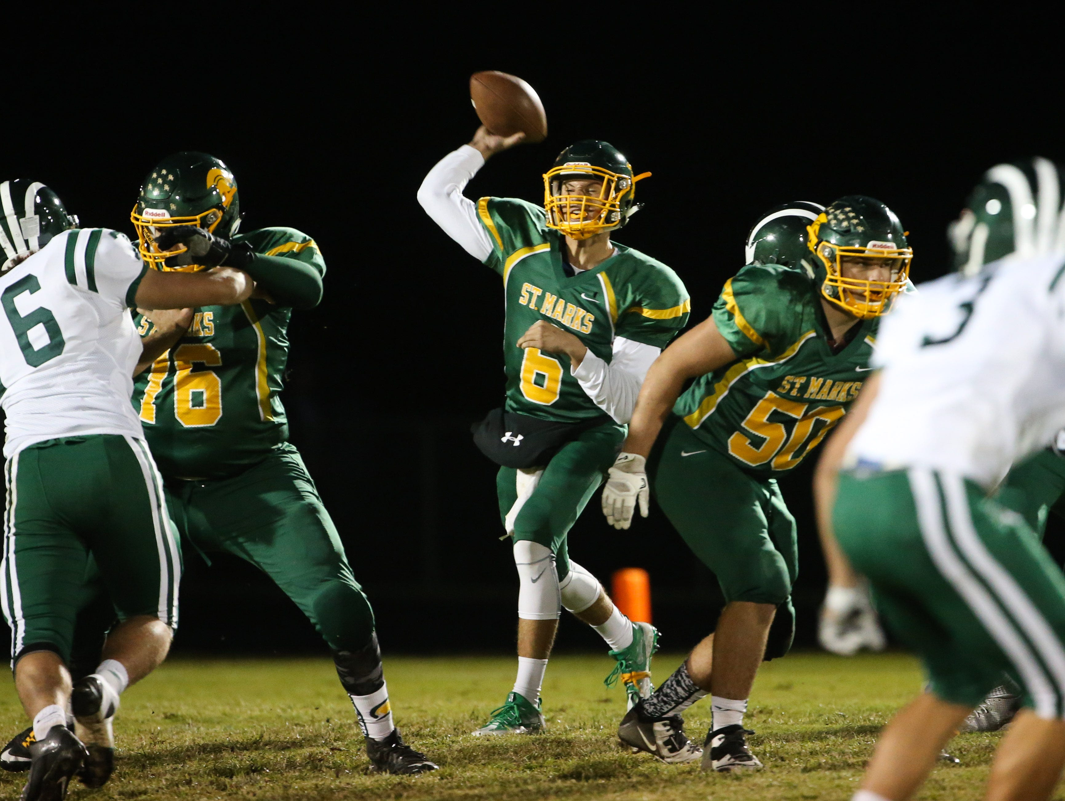 St. Mark's quarterback William Sullivan throws downfield in the second quarter of the Spartans matchup against Archmere at St. Mark's Friday.