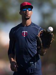 Byron Buxton of the Minnesota Twins tosses the ball with a teammate during Spring Training Practice on Monday.