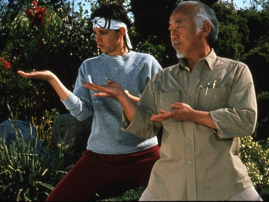 Daniel (left, Ralph Macchio) gets a lesson from Mr.