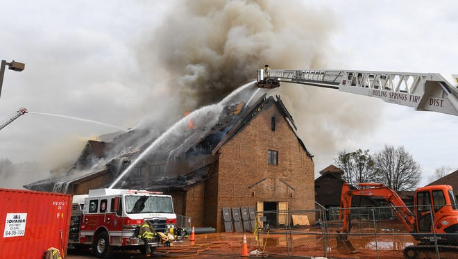 Fire crews fight a fire at Advent United Methodist Church in Simpsonville on Wednesday, February 8, 2017.