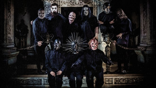 "Slipknot includes, back row, from  left, Jim Root, Corey Taylor, Mick Thomson and Sid Wilson; and front, Chris Fehn, Craig Jones and Shawn ""Clown"" Crahan."