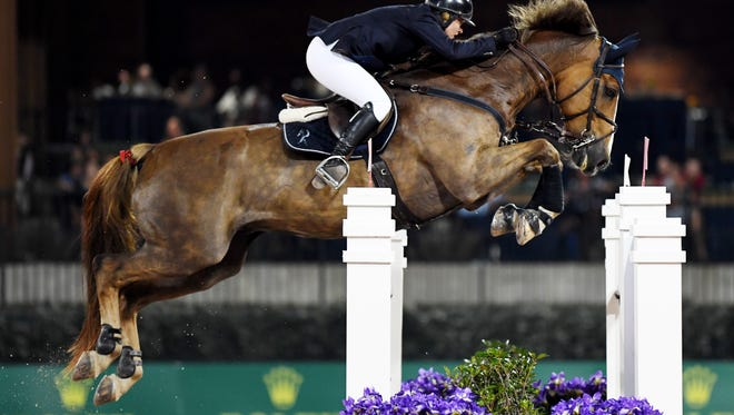 Callan Solem rides VDL Wizard in the $70,000 Carolina Arena Equipment Grand Prix CSI 2* during Saturday Night Lights at the Tryon International Equestrian Center July 14, 2018.