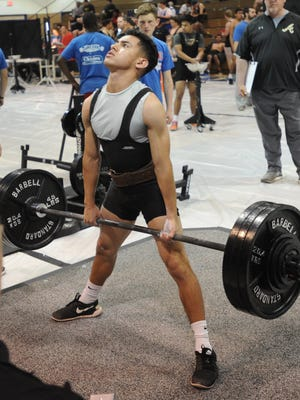 Abilene High's Alec Arrendondo lifts in the dead lift at the Region I Division I powelifting meet Saturday, March 11, 2017 at Cooper's Cougar Gym. He finished third in the 114-pound weight class with a 925 total, missing a state berth by 45 pounds.