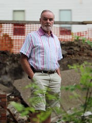 Ted Pacha stands on the property of the former Civil War-era cottages on Wednesday, July 15, 2015.