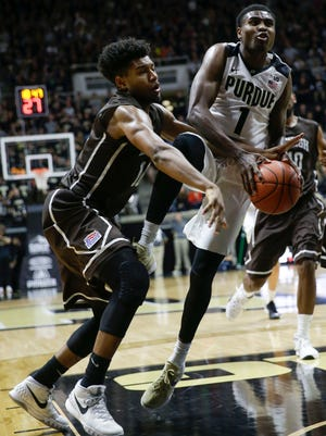 Lehigh guard Kyle Leufroy, left, fouls Purdue guard Johnny Hill in the second half of an NCAA college basketball game in West Lafayette, Ind., Saturday, Nov. 28, 2015. Purdue won 77-55. (AP Photo/AJ Mast)