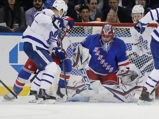 New York Rangers goaltender Igor Shesterkin (31) stops a shot on goal by Toronto Maple Leafs' Andreas Johnsso, left, during the second period of an NHL hockey game Wednesday, Feb. 5, 2020, in New York. (AP Photo/Frank Franklin II)