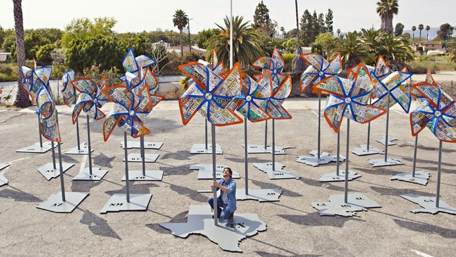 """Sculptor Michael Kalish is shown with his work, """"24M."""""""