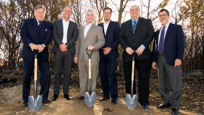 Joined by Northville Township Supervisor Robert Nix II, left, executives attend a groundbreaking for Hella's new U.S. headquarters and technical center. Next to Nix are Hella's Sven Hommel, vice president of purchasing; Steve Lietaert, president of Hella Corporate Center USA; Joerg Weisgerber, chief executive officer at Hella Electronics Corp.; and Nathan Crist, facilities manager; plus David Haboian, senior vice president of operations at the development company Redico.