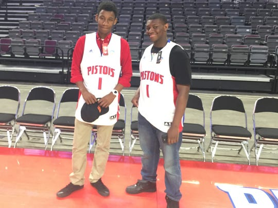 Rothus Stewart, left, and Christopher Taylor, both 15-year-old freshman at Detroit's Cody Academy of Public Leadership, show off Pistons jerseys they received during a visit to the Palace of Auburn Hills through former Detroit Mayor Dave Bing's mentorship group.