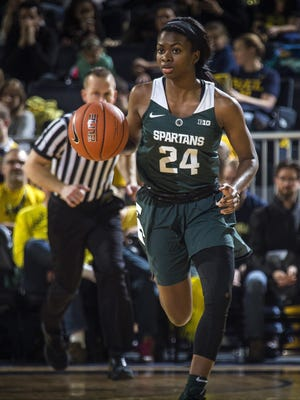 Nia Clouden and Michigan State moved up one spot to No. 22 in the Associated Press women's college basketball poll.