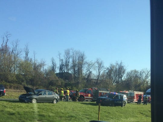 Emergency personnel attend to a crash reported Thursday evening on Route 30 eastbound near the Hellam exit.