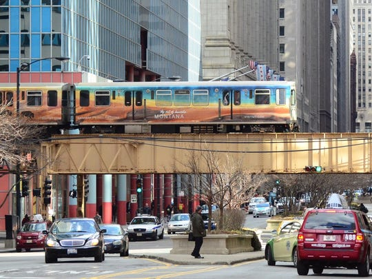 A train displays Montana's promotion of Yellowstone National Park  in  Chicago. Montana's  tourism office awarded a $7 million  contract to a Wisconsin firm.