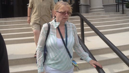 """Constance """"Gerrie"""" Post leaves federal court following a hearing in June 2013"""