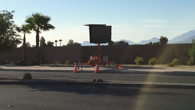 A warning sign informs drivers of upcoming traffic delays on Vista Chino. Lane closures will last a month as part of a bridge project.
