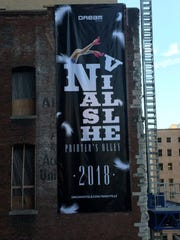 A banner announcing the Dream Nashville hotel that's planned to open next year.
