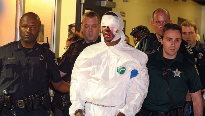 Markeith Loyd is escorted out of the Orlando Police headquarters in Orlando on Tuesday, Jan. 17, 2017.