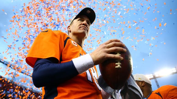 Broncos quarterback Peyton Manning celebrates after defeating the Patriots on Sunday.