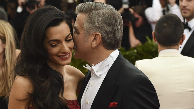 Amal Clooney and George Clooney arrive at the Costume Institute Gala Benefit at The Metropolitan Museum of Art May 5, 2015 in New York.