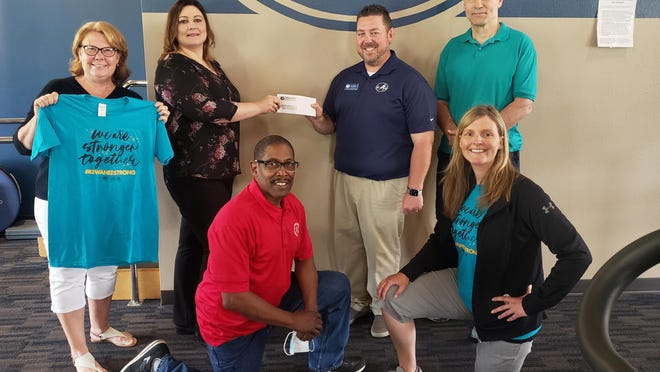 """Money exchanged hands last week as the Kewanee Physical Therapy and Rehab Specialist turned over a check for $3500 to the Kewanee Area United Way. The money was raised through the """"Kewanee Strong"""" t-shirt fundraiser that began last month. Back row, from left: Jill Dekeyser, KAUW board treasurer; Darcy James, KAUW board president; Jon DeBord,  KPT owner; and Bill Breedlove, owner of Breedlove's Sporting Goods.  Front row: Eddie Toliver, KAUW board director; and Autumn McGarvey, KPT certified personal trainer."""