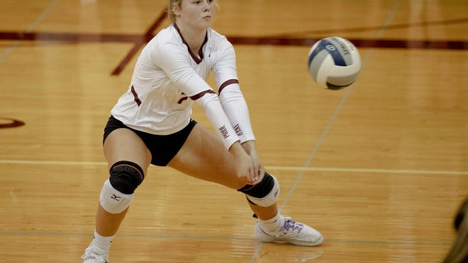 Dripping Springs' Nicole Herbert, digging the ball in a match against McCallum last year, had 18 digs in the Tigers' straight-sets playoff win versus Alamo Heights on Friday.