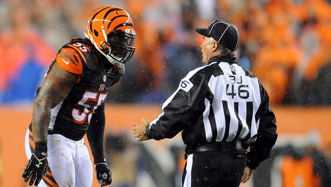 Cincinnati Bengals outside linebacker Vontaze Burfict (55) talks with back judge Perry Paganelli (46) during the second quarter in the AFC Wild Card playoff football game at Paul Brown Stadium.