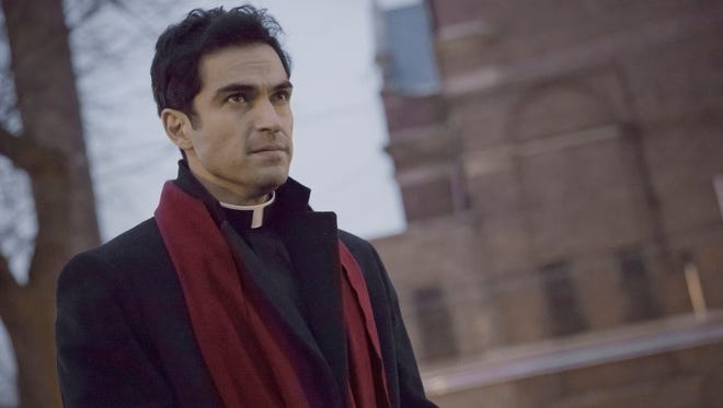 Alfonso Herrera plays a priest hunting demons in Fox's remake of 1973 film 'The Exorcist.'