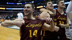 Loyola Ramblers guard Ben Richardson, left, Cameron
