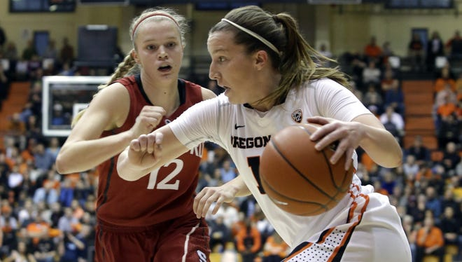 Oregon State guard Ali Gibson, right, drives on Stanford guard Brittany McPhee during the first half of an NCAA basketball game in Corvallis, Thursday, Feb. 26, 2015