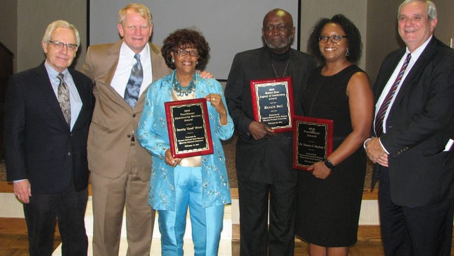 Pictured, from left, Bob Clement, Ted Williams, Dorothy C. Driver, Harold Bell, Dr. Tamara Baynham and Darrell James.