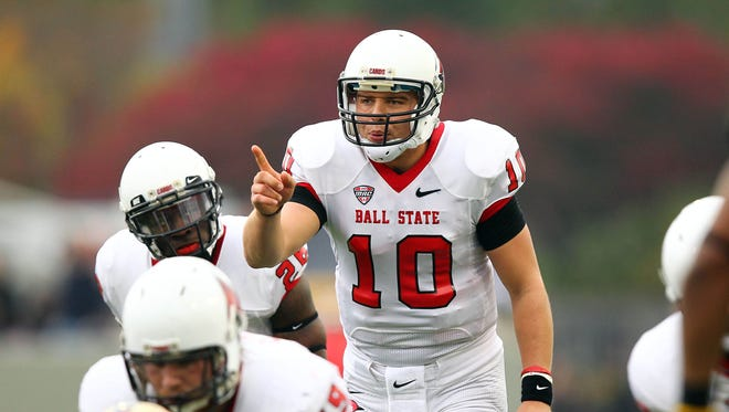 Ball State Cardinals quarterback Keith Wenning (10) calls a play against the Army Black Knights at Michie Stadium.