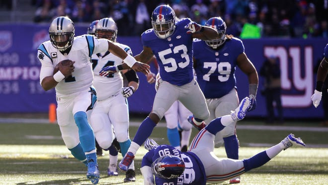 Carolina Panthers quarterback Cam Newton (1) breaks a tackle by New York Giants' Jason Pierre-Paul (90) during the first half of an NFL football game in East Rutherford, N.J., Dec. 20. We know the Panthers won the NFC South in 2014, but they did it with a 7-8-1 record. Their playoff win was over a severely undermanned Arizona. To see them win their first 14 games and for Newton to emerge as one of the NFL's elite players was unexpected.