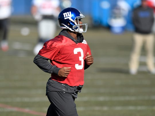 New York Giants quarterback Geno Smith runs onto the field to begin practice on Wednesday, November 29, 2017 in East Rutherford, NJ. Smith was named the starting quarterback to face the Oakland Raiders this Sunday.