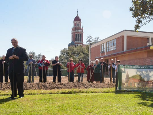 Father Chester Arceneaux speaking at the Cathedral Carmel Catholic School ground breaking ceremony for a new family center. Feb 26, 2016.