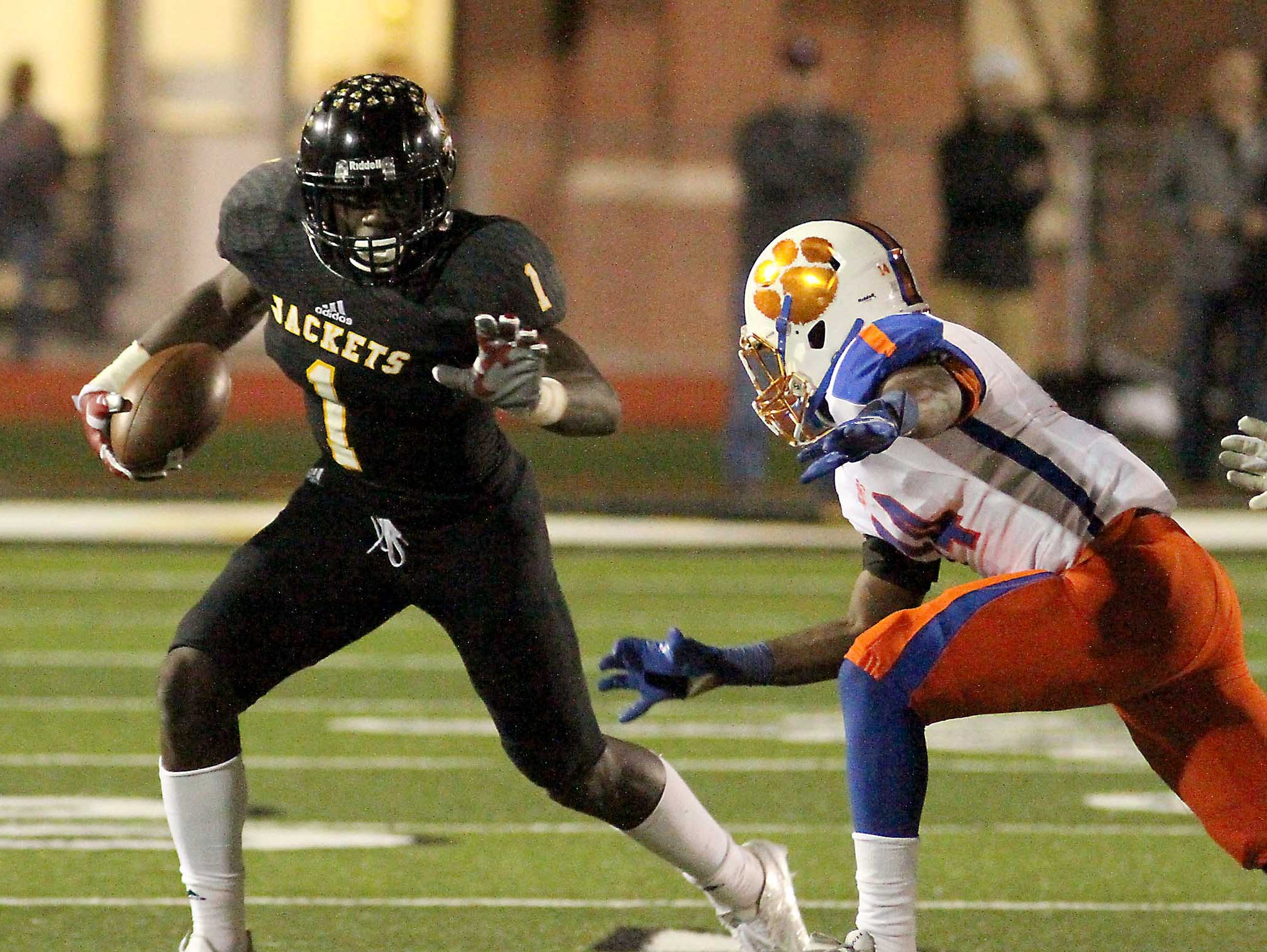 Starkville High's A. J. Brown (1) sprints away from Madison Central's AJ Brown (14) during the first half of the 6A North Half championship game in Starkville on Friday, Nov. 27, 2015. (Special to the Clarion Ledger/ Jim Lytle)