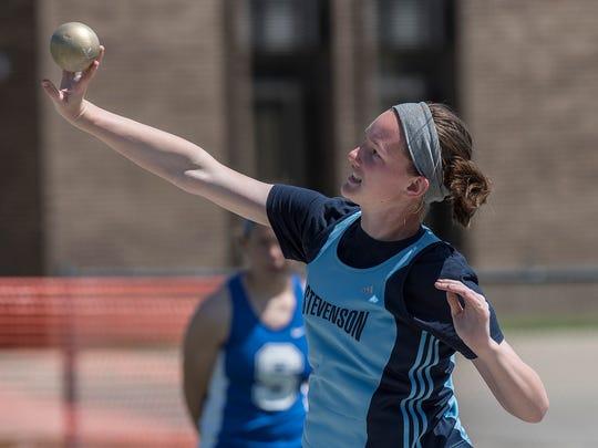 Emma Ryan, of Stevenson, throws the shot.