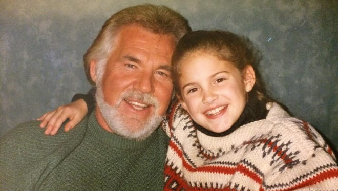 Maggie Dame of De Pere was 8 years old when she performed with Kenny Rogers on his national TV special in 1992.