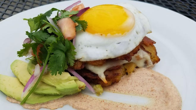 Plaintain fritters stuffed with bacon and cheese and topped with a fried egg, pico de gallo and avocado will be served at Me So Hungry Hip Hop Breakfast Cafe when the West Des Moines restaurant opens in August.