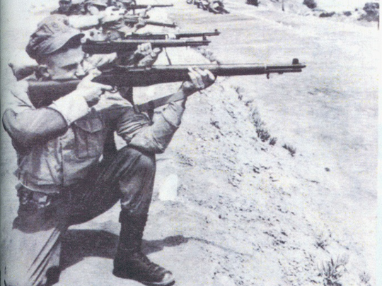 In this foreboding picture, Lee Harvey Oswald fires a rifle at Marine boot camp in San Diego in 1956. Six Evansville men were in boot camp with Oswald.