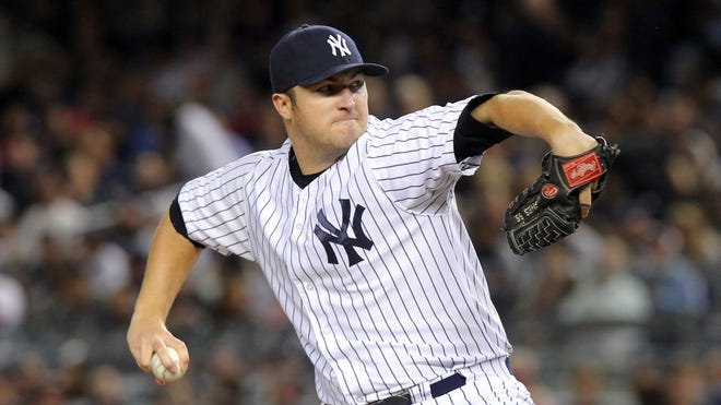Phil Hughes went 4-14 with a 5.19 ERA for the Yankees last season.