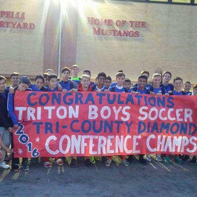 The Triton boys' soccer team celebrated its Tri-County Conference Diamond Division championship on Tuesday.