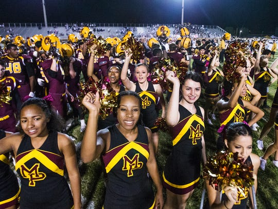 Mountain Pointe cheerleaders celebrate the Pride's