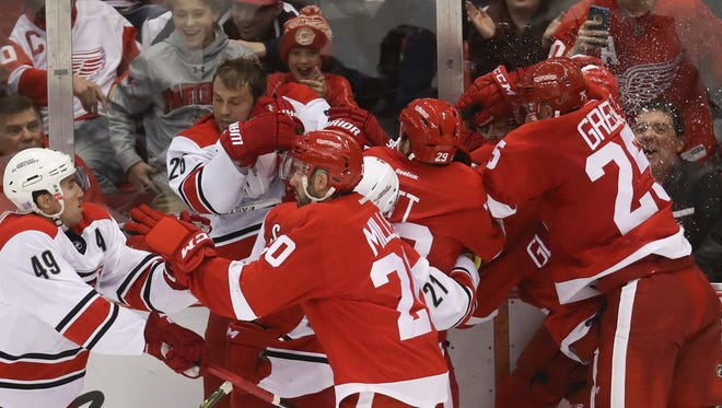 Red Wings forward Steve Ott fights with the Hurricanes' Viktor Stalberg during the third period of the Wings' 4-2 win Tuesday at Joe Louis Arena.