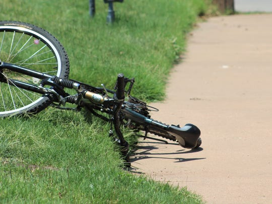 A cup sits upright near the bicycle a man shot twice Friday near the intersection of South Third and Larkin Streets in Abilene. The injuries to the man were not life-threatening.