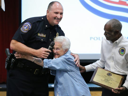 IMPD Commander James Waters gets a hug, 2014.