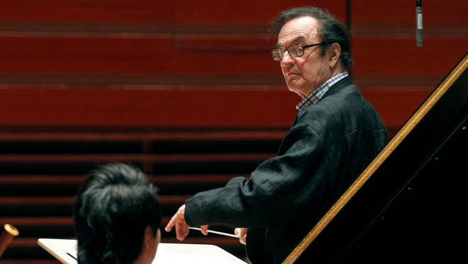 In this Oct. 19, 2011 file photo, world-renowned conductor Charles Dutoit, right, performs with the Philadelphia Orchestra during a rehearsal in Philadelphia.