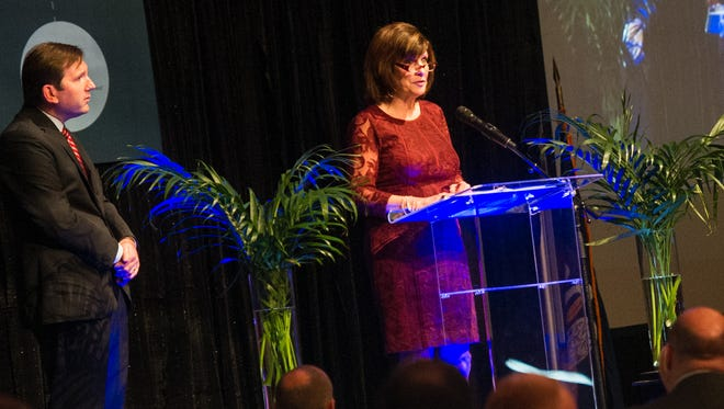 Julie Dronet address the attendees at the One Acadiana annual banquet at the Cajundome Convention Center Wednesday.