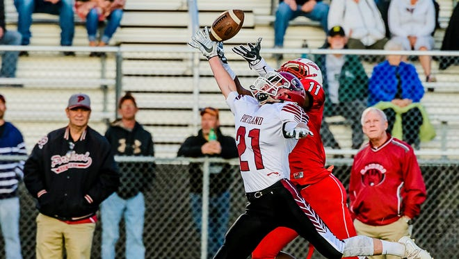 Gavin Dennany of Portland breaks up a pass meant for Karl Brooks of Sexton late in the 2nd quarter of their game Thursday August 31, 2017 in Lansing.