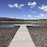 This Monday, Aug. 24, 2015, file photo shows the lake bed where water has dried due to the drought at Big Bear Lake, Calif.