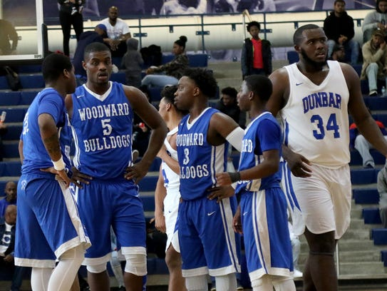 Woodward's Terry Durham  and his teammates during the